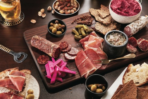 Charcuterie-board-with-meat-pickles-and-hummus